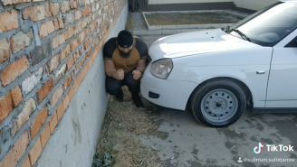 This Video Of 'The Rock' Getting CRUSHED Between Two Cars Is Truly As Russia As It Gets